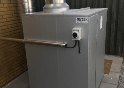 Udsugningsventilator til olietåger